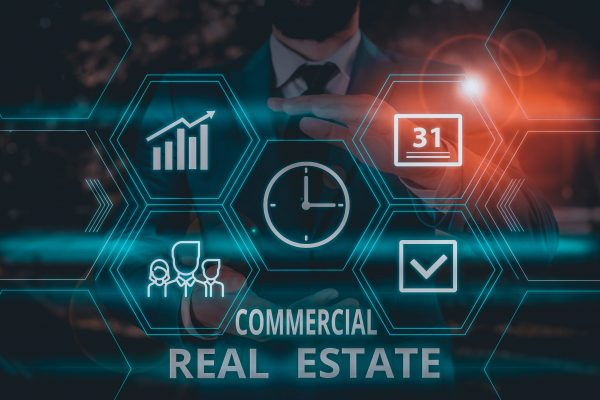 Word writing text Commercial Real Estate. Business concept for Income Property Building or Land for Business Purpose Male human wear formal work suit presenting presentation using smart device.